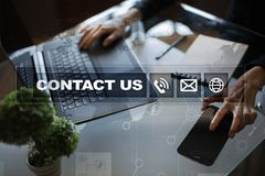 Contact us button and text on virtual screen. Business and technology concept.  stock photos
