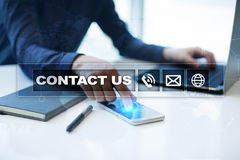 Contact us button and text on virtual screen. Business and technology concept. Stock Image