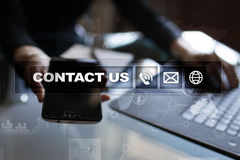 Contact us button and text on virtual screen. Business and technology concept. Contact us button and text on virtual screen. Business and technology concept royalty free stock image
