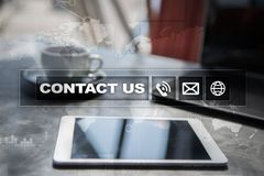 Contact us button and text on virtual screen. Business and technology concept. Contact us button and text on virtual screen. Business and technology concept Stock Image
