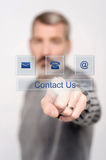 Contact us button on virtual screen Royalty Free Stock Image