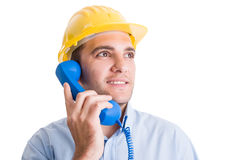 Contact us concept with builder using phone Royalty Free Stock Photo