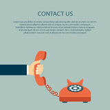 Contact us concept. Contact us. Hand holding the headset with text. Flat  illustration Stock Photography
