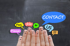 Contact us concept with happy fingers Stock Images