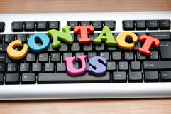 Contact us concept with letters Stock Photos