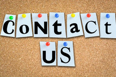 Contact us concept with memo papers on cork billboard and pins Stock Images