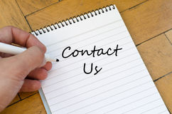 Contact us concept on notebook Stock Photography