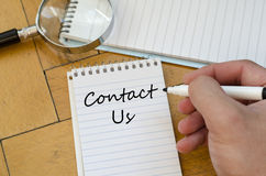Contact us concept on notebook Royalty Free Stock Photo