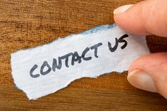 Contact us concept and theme written on old paper on a grunge background. The word Contact us concept and theme written on old paper on a grunge background royalty free stock images