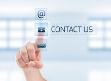 Contact us concept using female hand Royalty Free Stock Photo