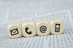Contact us cubes on a newspaper Royalty Free Stock Image