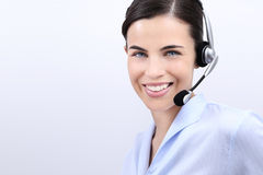 Contact us, customer service operator woman with headset smiling. On white background Royalty Free Stock Images