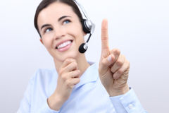 Contact us, customer service operator woman with headset, touch Royalty Free Stock Images