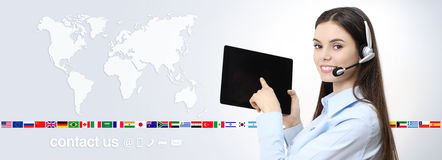 Contact us, customer service operator woman pointing screen. Contact us, customer service operator woman pointing digital tablet, with headset smiling isolated Royalty Free Stock Images