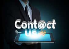 Contact us 3D text on touch screen tablet technology. Social network concept Royalty Free Stock Image
