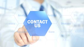 Contact Us, Doctor working on holographic interface, Motion Graphics Stock Image