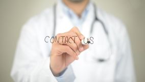 Contact Us, Doctor writing on transparent screen Stock Image
