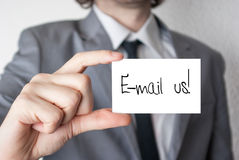 Contact us by e-mail. Contact us concept businessman holding or showing card Stock Images
