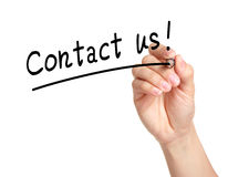 Contact us. Hand with pen writing contact us royalty free stock photography