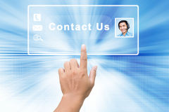 Contact Us. Hand Pressing On Contact Us Screen Concept Background Stock Images
