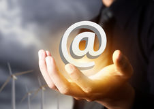 Contact us icon in businessman hand Stock Images
