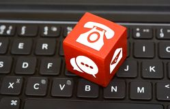 Contact Us icons on Red Dice on top of keyboard Customer service.  Royalty Free Stock Photography