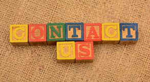Contact Us Idea on word blocks Customer Service concept.  Stock Photo