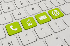 Contact us - keyboard - green Stock Photography
