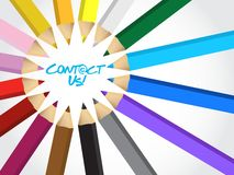 Contact us message around a set of colors Royalty Free Stock Photography