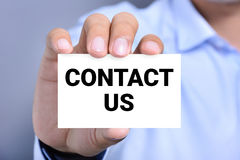 CONTACT US message on the card Royalty Free Stock Images