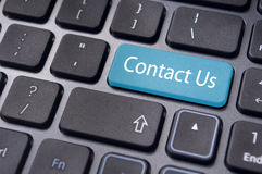 Contact us message on enter key, for online conctact. A contact us message on enter key of keyboard, for online communications Stock Image