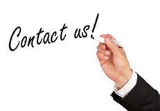 'Contact us!' message on whiteboard Royalty Free Stock Images