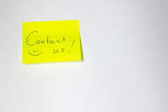 Contact us Motivational post-it Royalty Free Stock Photography