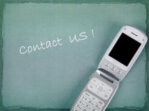 CONTACT US with phone and copy space Stock Image