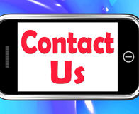 Contact Us On Phone Shows Communicate Online Stock Photo
