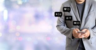 Contact us sms media man use smart phone social media network. Pop notification icons Stock Images