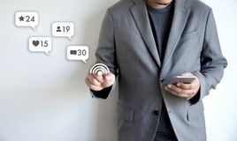 Contact us sms media man use smart phone social media network. Pop notification icons Stock Photos