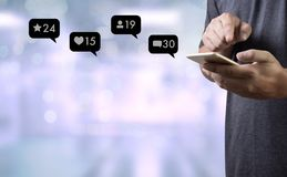 Contact us sms media man use smart phone social media network. Pop notification icons Royalty Free Stock Photography
