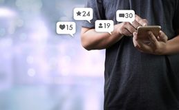 Contact us sms media man use smart phone social media network. Pop notification icons Stock Photography