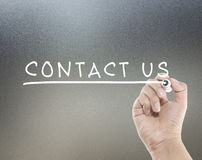 Contact us text. With hand writing Stock Photography