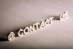 CONTACT US text made from white letters stock photo
