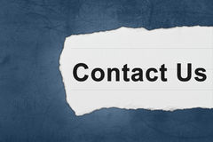 Contact us with white paper tears Royalty Free Stock Photos