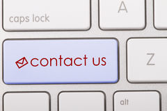 CONTACT US. Word written on computer keyboard royalty free stock photo