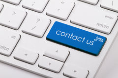 CONTACT US. Word written on computer keyboard Stock Photography