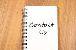 Contact us write on notebook Stock Images