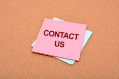 Contact Us written on notepad with background texture Royalty Free Stock Images