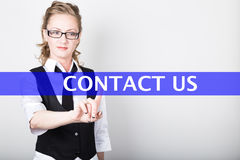 Contact us written on a virtual screen. Internet technologies in business and tourism. woman in business suit and tie Stock Photo