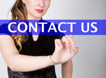 Contact us written on virtual screen. technology, internet and networking concept. woman in a black business shirt Royalty Free Stock Image