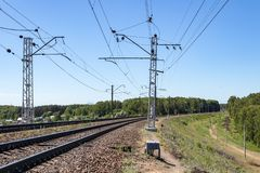 Contact wires and broad gauge rails in the perspective of the spring day. industry railway transportation, logistics. Moscow. Region Russia royalty free stock photo