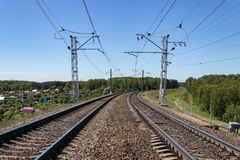 Contact wires and broad gauge rails in the perspective of the spring day. industry railway transportation, logistics. Moscow. Region Russia stock photos